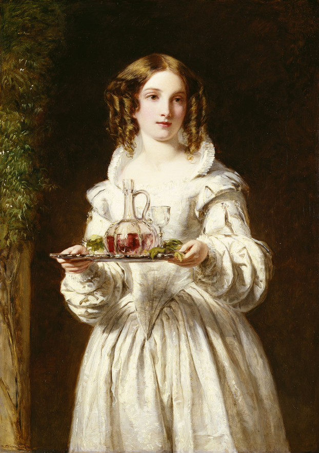 A three-quarter-length portrait of a young woman standing in a doorway, holding a tray. She wears Elizabeth costume: a pale dress with a starched collar, voluminous sleeves, a pointed bodice and full skirt; her blonde hair, however, is in distinctly Victorian ringlets on either side of her face. The silver tray bears a small wine glass and a decanter of red wine; to the left is a vine evidently framing the doorway.