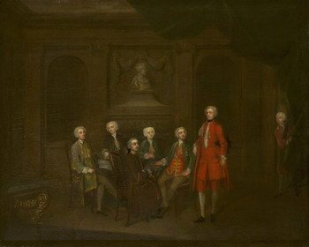 An oil painting of a group of men seated around a table in a dimly-lit room. A bust of Henry V is over the fireplace. All of them wear powdered wigs and fashionable frock coats. The most prominent figure stands to the right of the table in a striking red silk suit. Prince Frederick appears in the doorway on the far right, peering around a curtain.
